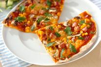 コーンとソーセージのピザ