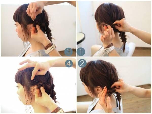 左右の三つ編みをクロスして、毛先を内側に入れ込みピンでとめる。