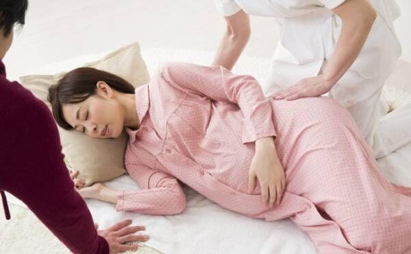 陣痛中の妊婦さんのイメージ