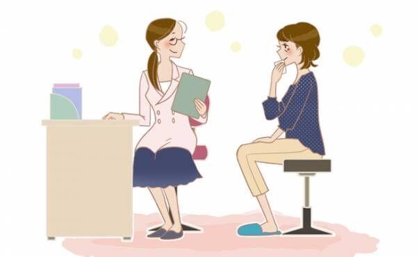 カウンセラーを受ける女性のイメージ