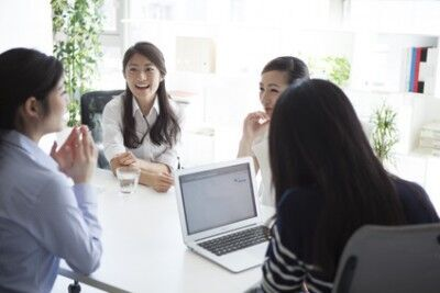 Four of the women, have a meeting in the office