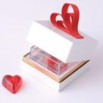 あめやえいたろうより「スイートハート」10周年記念の飴、赤いハートのリボン付きのリングケース