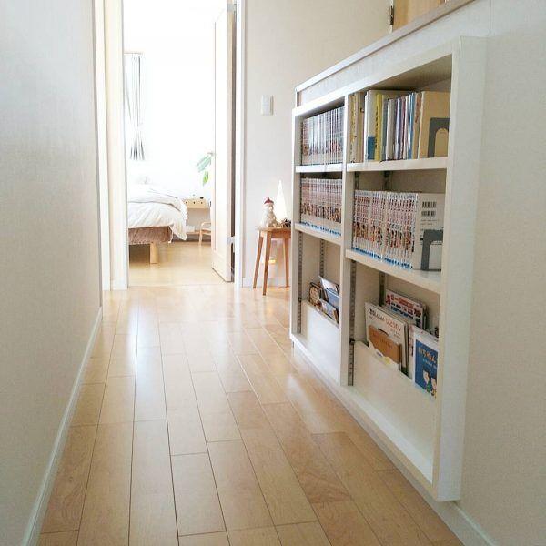 階段壁を本棚として使う