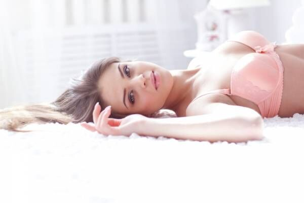 A woman laying down in lingerie