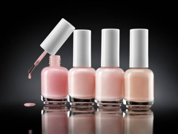 Set of bottles pearl colors nail polish on dark background