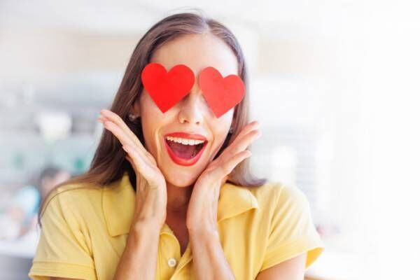 emoji concept: woman with the hearts instead of her eyes