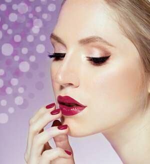woman with red lips and manicure
