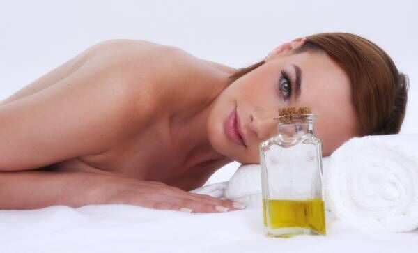 woman and massage oil