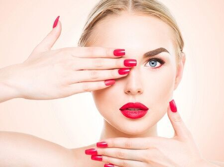 45104886 - beautiful woman with blond hair. fashion model with red lipstick and red nails. portrait of glamour girl with bright makeup. beauty female face. perfect skin and make up close up