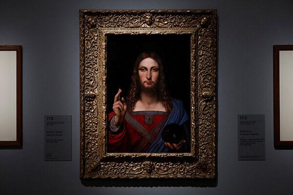 ルーブル美術館に展示されているダ・ヴィンチの『サルバトール・ムンディ』(写真:ロイター/アフロ)