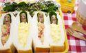 春眠暁を覚えず。ウインナーに顔を付けたらサンドイッチが寝袋みたいで可愛い